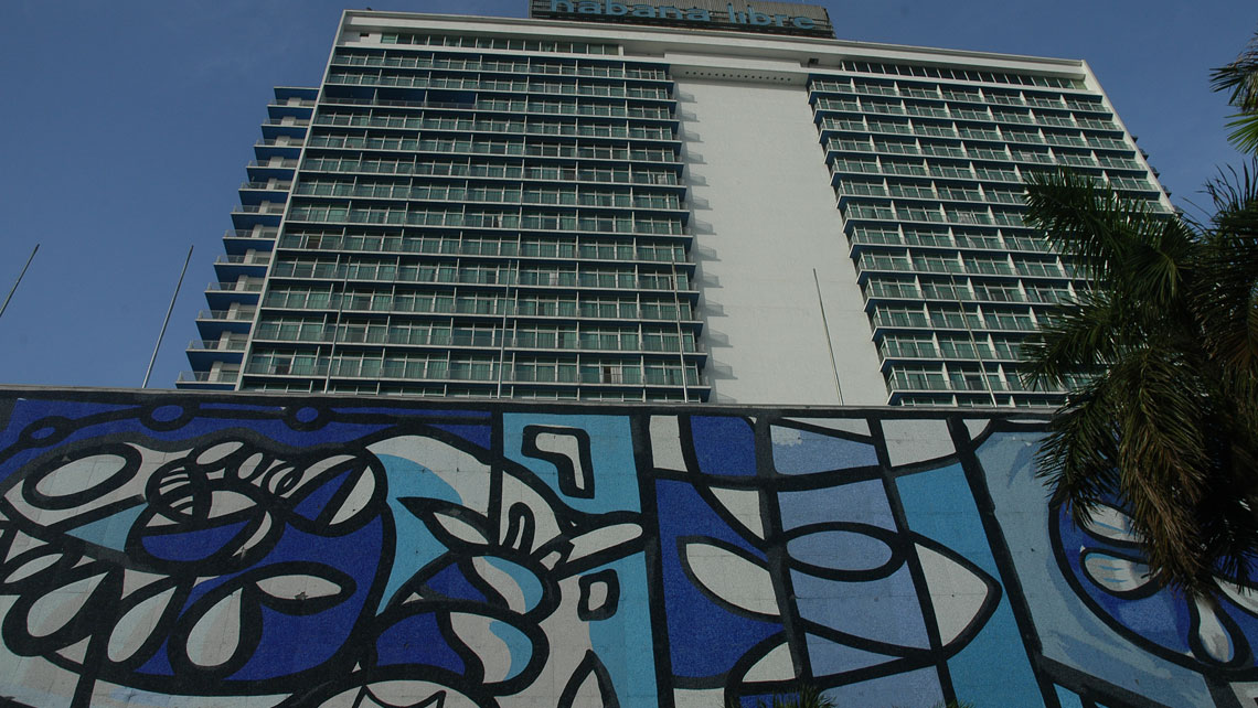 Facade of the Habana Libre hotel featuring an iconic mural by Amelia Pelaez