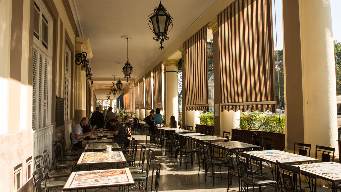 A sidewalk cafe in the ground floor of Hotel Inglaterra