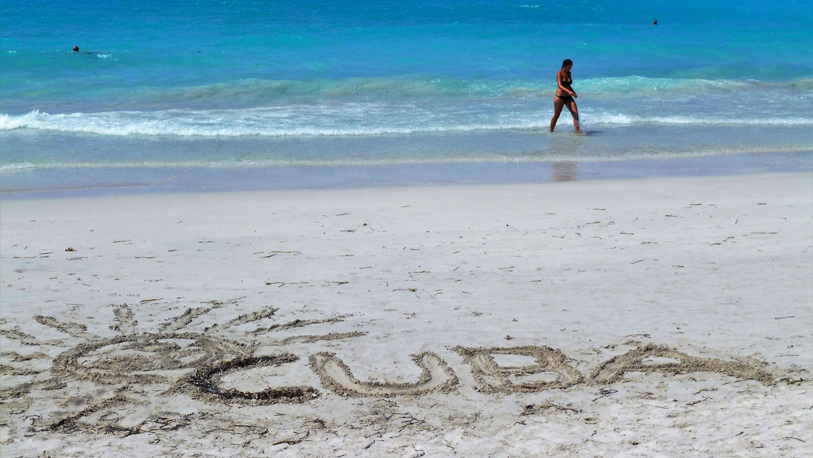The word Cuba left in the sand by a beachgoer is seen in Varadero Beach