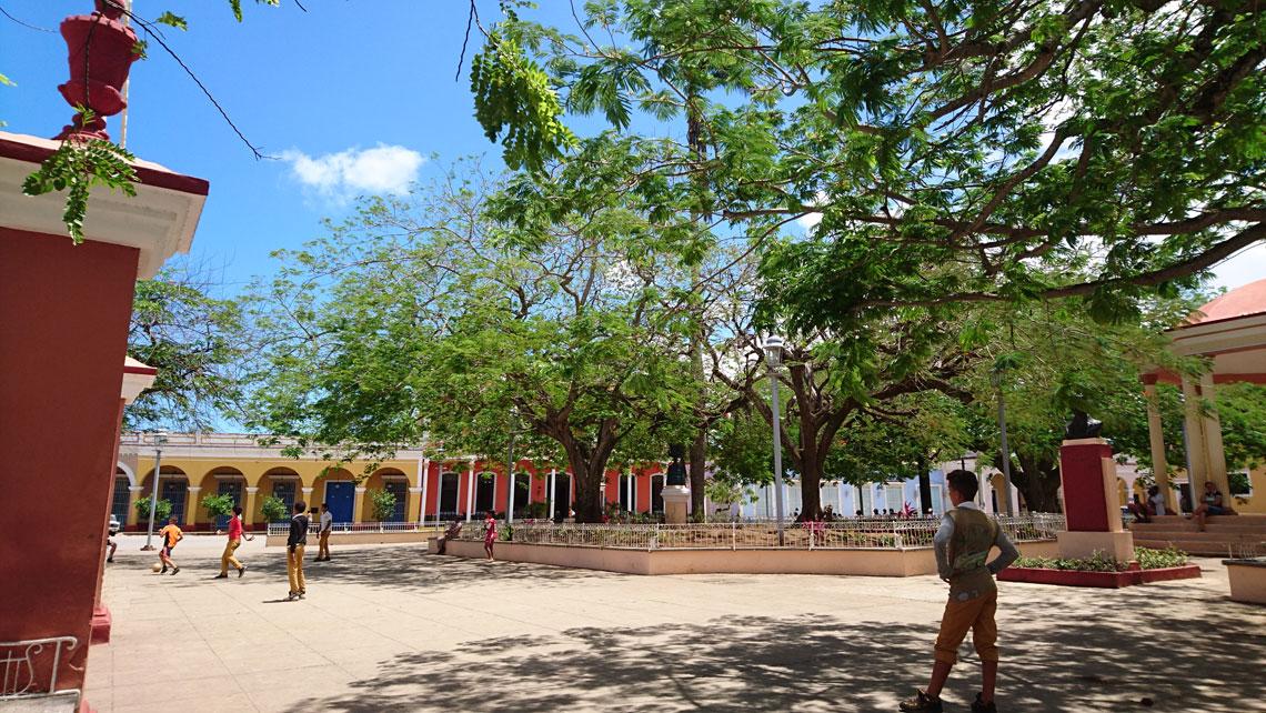 Kids playing football in a park in Remedios, Villa Clara