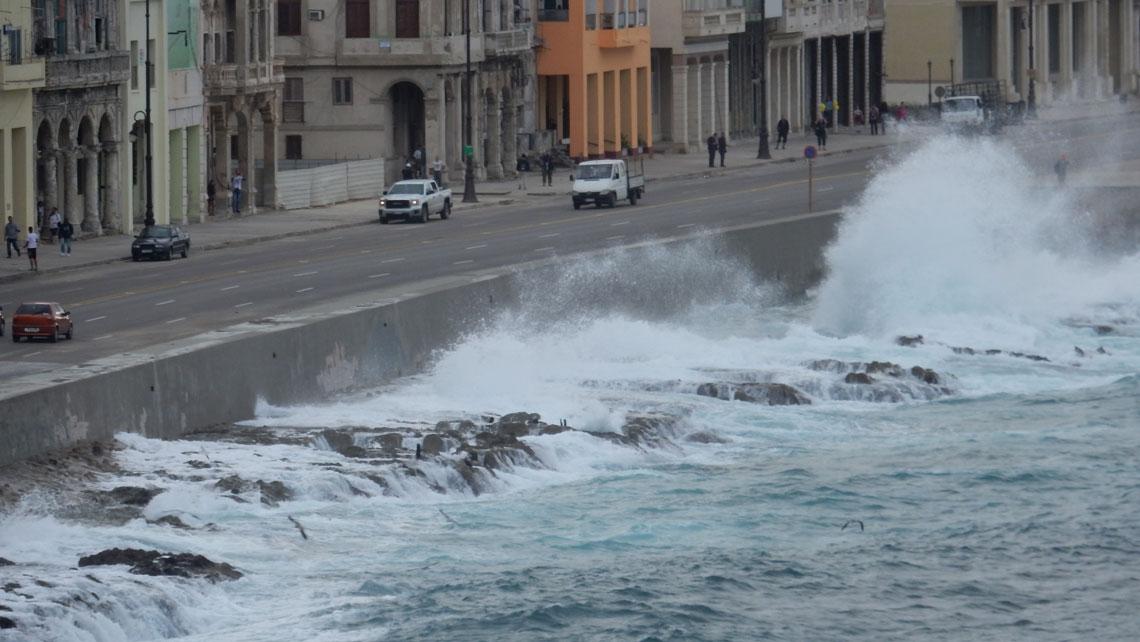 Violent waves crashing against El Malecon in Havana, Cuba