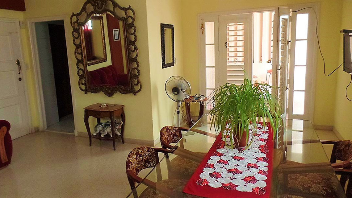A colourful living room of a Casa Particular in Cuba