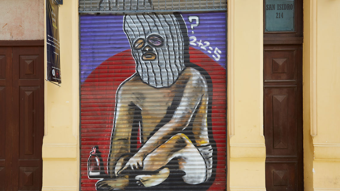 A graffiti that says 2 + 2 = 5 with a question mark on a wall in San Isidro, Havana